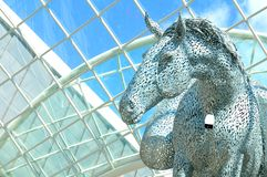 Futuristic architecture. LEEDS, UK - APRIL 17, 2015: Close up of modern equestrian sculpture entitled Equus Altus by Andy Scott inside Trinity shopping centre in Stock Image