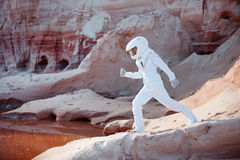Futuristic astronaut on another planet, image with Royalty Free Stock Photography