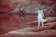 Futuristic astronaut on another planet, image with Royalty Free Stock Image