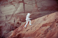 Futuristic astronaut on another planet, image with Stock Photo