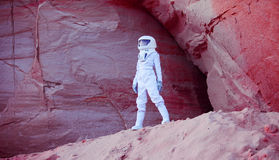 Futuristic astronaut on crazy pink planet, image Royalty Free Stock Photo