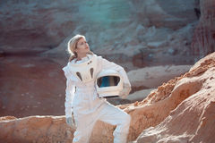 Futuristic astronaut without a helmet on another Royalty Free Stock Photos