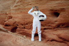 Futuristic astronaut without a helmet on another Royalty Free Stock Photo