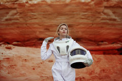 Futuristic astronaut without a helmet on another Royalty Free Stock Image