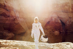 Futuristic astronaut without a helmet in rays of Royalty Free Stock Photo