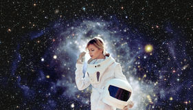Futuristic astronaut without  helmet,  space backgrounds. Elements of this image furnished by NASA. Futuristic astronaut without  helmet, the white background Stock Images