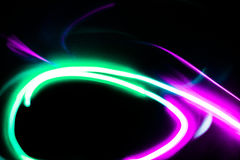 Futuristic background of magenta and green color. Created by light motion stock photos