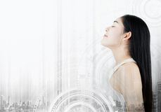 Futuristic beautiful Asian young woman, with technology interface graphic on white background. Beauty, cosmetic, treatment and sur Royalty Free Stock Photos