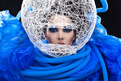 Futuristic beautiful young female face with blue fashion make-up. Royalty Free Stock Photography