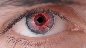 Futuristic Biometric Retina scanner scaning human eye. Macro shot of man`s eye