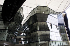 Futuristic building. Futuristic Angular green glass building structure connected by aero bridge with white canvas canopy Stock Images