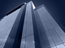 Futuristic Building. Modern Glass Building stands tall Royalty Free Stock Images