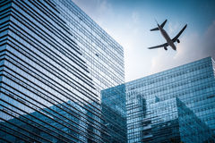 Futuristic building with airplane Stock Photo
