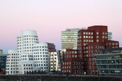 Futuristic buildings in Dusseldorf, Germany. DUSSELDORF, GERMANY - SEPT 4: View of the Neuer Zollhof, designed by the architect Frank O. Gehry and completed in Stock Photo