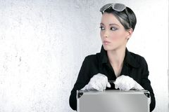 Futuristic businesswoman holding silver briefcase Royalty Free Stock Photography