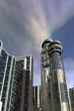Futuristic city. A futuristic city with skycreepers and cloudy sky in background in 3D Stock Image