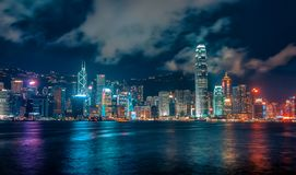 Futuristic City Skyline at Night with Colourful Lights and Reflections, Hong Kong. Futuristic Dystopian City Skyline at Night with Colourful Lights and stock photo