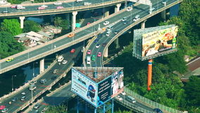 Futuristic cityscape aerial view panorama with cars moving on highway. Bangkok, Thailand stock video footage