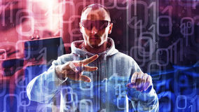 Futuristic cyber crime, man typing on holographic computer Royalty Free Stock Photos