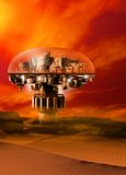 A futuristic domed city. Situated in a baren sand filled landscape with a bright firey sky Stock Images
