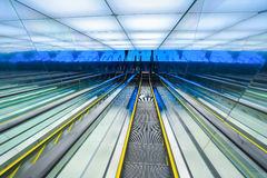 Futuristic downward escalator Stock Photography