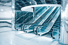 Futuristic escalator. In modern office Royalty Free Stock Photos