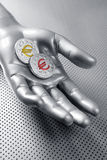 Futuristic euro business coin silver hand Stock Photo