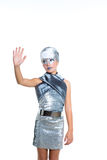 Futuristic fashion children girl silver makeup. Children futuristic fashion children girl rising hand up silver makeup on white royalty free stock photography