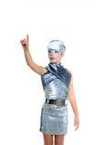 Futuristic fashion children girl silver makeup. Children futuristic fashion children girl pointing finger silver makeup on white stock photo