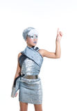Futuristic fashion children girl silver makeup. Children futuristic fashion children girl pointing finger silver makeup on white stock images