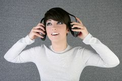 Futuristic fashion woman hearing music headphones Stock Image