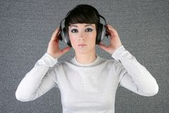 Futuristic fashion woman hearing music headphones Stock Photo