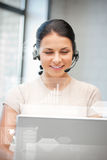 Futuristic female helpline operator Royalty Free Stock Photo