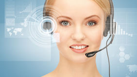 Futuristic female helpline operator. With headphones and virtual screen Royalty Free Stock Images