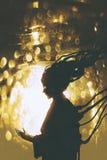Futuristic female robot silhouette on golden light background Stock Photos