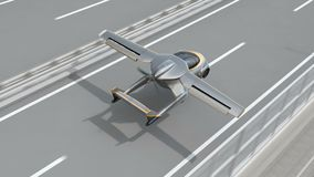 Futuristic flying car landing on highway
