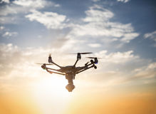 Futuristic flying drone with stabilizer camera on a spectacular Royalty Free Stock Photos