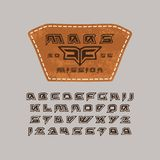 Futuristic font in the style of handmade graphics. Leather patch with space emblem. Print on grey background Stock Photo