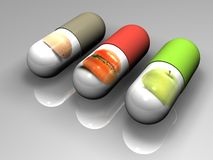 Futuristic food. Pills on a grey background with pictures of food on it Royalty Free Stock Images