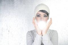 Futuristic fortune teller woman light glass sphere Stock Image