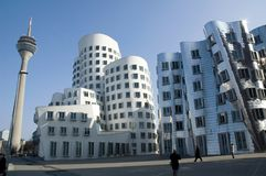 Futuristic Gehry houses in Medienhafen in Düsseldorf, germany stock photos