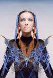 Futuristic girl. With blue and orange energy flows. Art concept Stock Image