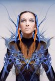 Futuristic girl with blue and orange energy flows Stock Photos