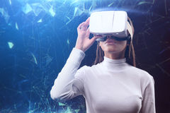 Futuristic girl with vr headset Royalty Free Stock Images