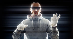 Futuristic hacker in white gloves Royalty Free Stock Image