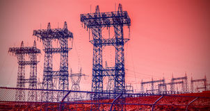 Futuristic industrial vision, pylons and transmission power line Stock Photography