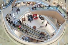 Futuristic interior renovated shopping center Stock Images