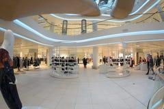 Futuristic interior renovated shopping center Stock Photos
