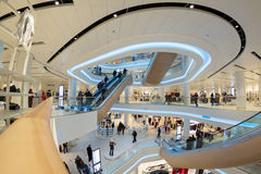 Futuristic interior renovated shopping center Stock Photos