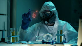 Futuristic laboratory gadget or device with transparent interface screen. Professional scientist in protective clothes stock video footage